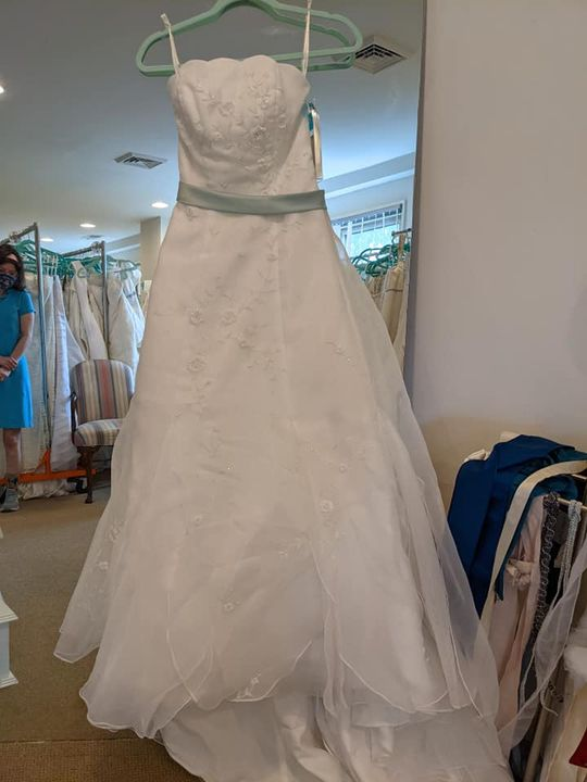 Featured favorites:On the left is a lovely white dress with subtle mint green accents (roughly size 2) On the right is a...