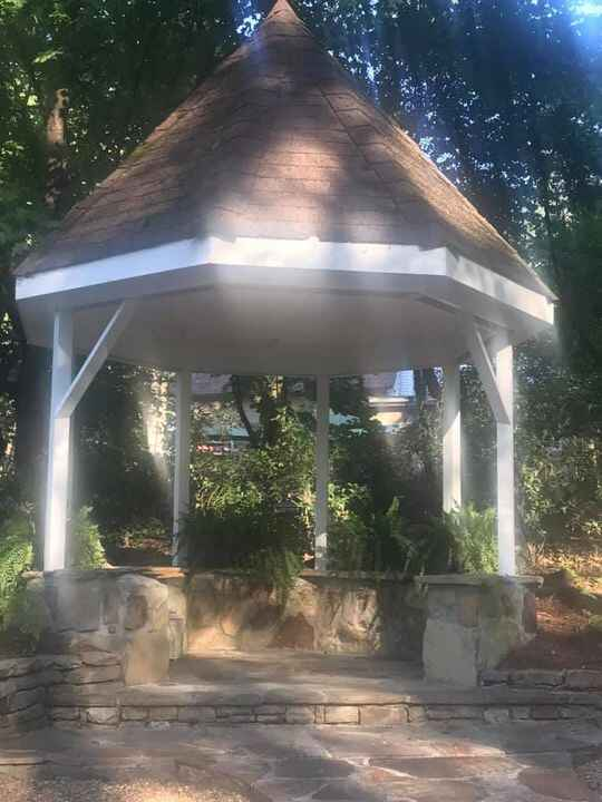 The before picture of the gazebo and the after. About 100 hydrangeas and greenery swags went on the gazebo front three s...